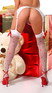 Gorgeous blond stripping in a Xmas outfit